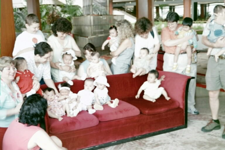 All 12 babies NEAR the Red couch
